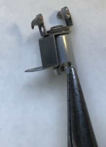 Adjustment with needle nosed pliers